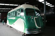 This was the 'pay wagon' that would travel up and down the tracks delivering pay to the rail workers. It looks like this because it was designed as a hybrid between a train car and an automobile.